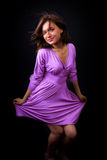 Happy fresh woman with elegant violet dress Stock Photos