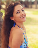Happy fresh woman face looking with smile on summer Royalty Free Stock Image