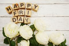 Happy friday alphabet letters with peony flower on wooden background. Happy friday alphabet letters with white peony flower on wooden background royalty free stock photos