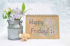 Happy Friday card with happy elephant clay and tin flower pot. Over blurred white background royalty free stock images