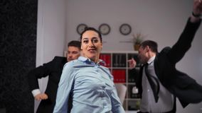 We happy of Friday ending businesspeople dancing cheerfully in office in front of the camera. stock video footage