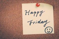 Happy Friday. Note pin on bulletin board stock image