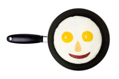 Happy Fried Egg. In a frying pan Stock Images