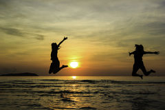 Happy friend jump enjoy sunrise Stock Photography