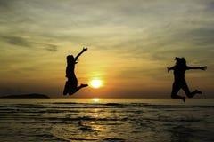 Happy friend jump enjoy sunrise. On the beach Stock Photography