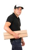 Happy friendly confident delivery man carrying Royalty Free Stock Images