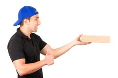 Happy friendly confident delivery man carrying Stock Photo