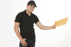 Happy friendly confident delivery man with Royalty Free Stock Photo