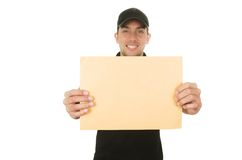 Happy friendly confident delivery man holding Royalty Free Stock Photography