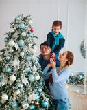 Happy friendly family decorating Christmas tree have fun stock photography