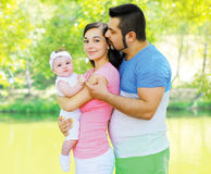 Happy friendly family in summer day. Happy friendly family walking in summer day Stock Photo