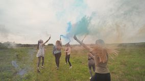 Happy friendly girls friends are running with toy planes that emit colored smoke. Happy friendly girls friends are running with toy planes that emit colored stock footage