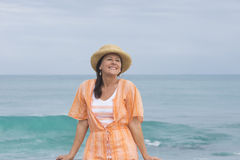 Happy friendly mature woman beach ocean Stock Images