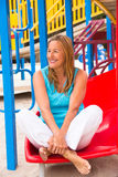 Happy friendly mature woman playground outdoor Stock Photos