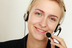 Happy friendly service agent in call centre.  Stock Photos