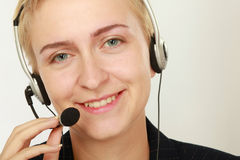 Happy friendly service agent in call centre.  Royalty Free Stock Image