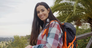 Happy friendly woman wearing a backpack Stock Photos