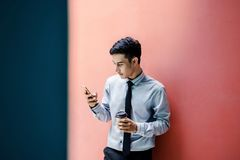 Happy and friendly young attractive Businessman use a Smart phon Royalty Free Stock Photos