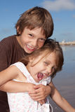 Happy friends. Portrait of two kids laughing and playing on a sunny summer day Royalty Free Stock Photos