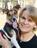 Happy friends. Woman smiling with a happy Jack Russell dog Stock Photos