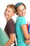 Happy friends. Two happy kids go into a school stock image