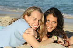 Happy friends. Two  beautiful  women  on the beach Stock Photography