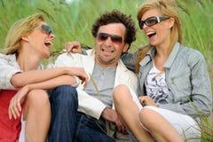 Happy friends. Having fun on the beach Stock Photography