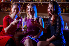 Happy friends at bar Royalty Free Stock Photography