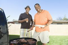 Happy Friends Barbecuing Stock Photo