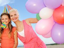 Happy friends on the beach Stock Photography