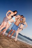 Happy Friends on Beach Royalty Free Stock Image