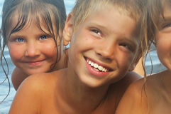 Happy friends on the beach royalty free stock photography