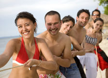 Happy friends at the beach Stock Photography