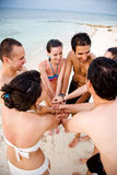 Happy friends at the beach Stock Images