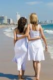Happy friends on beach. Two beautiful woman best friends on beach having fun Royalty Free Stock Photo
