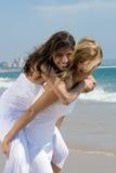 Happy friends on beach. Two beautiful woman best friends on beach having fun Stock Photography