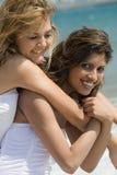 Happy friends on beach. Two beautiful woman best friends on beach having fun Royalty Free Stock Image