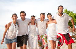 Happy friends at the beach Stock Image