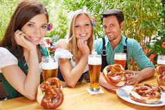 Happy friends in beer garden Royalty Free Stock Image