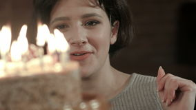 Happy friends birthday celebrating with candle on cake in club stock footage