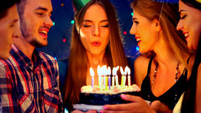 Happy friends birthday party with candle celebration cakes. Stock Photography