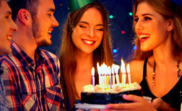 Happy friends birthday party with candle celebration cakes. Royalty Free Stock Photography