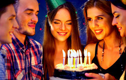 Happy friends birthday party with candle celebration cakes. Stock Photo