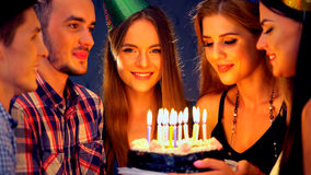 Happy friends birthday party with candle celebration cakes in club. Royalty Free Stock Photography