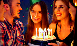 Happy friends birthday party with candle celebration cakes in club. Stock Photo