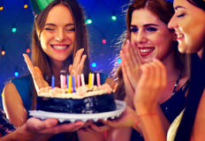 Happy friends birthday party with candle celebration cakes. Stock Image