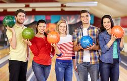 Happy friends in bowling club Royalty Free Stock Images