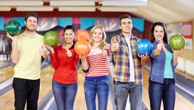 Happy friends in bowling club Stock Images