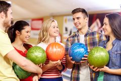 Happy friends in bowling club Royalty Free Stock Photo