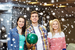 Happy friends in bowling club at winter season Royalty Free Stock Photo